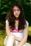 A menina adolescente comprimiu Fotos de Stock Royalty Free