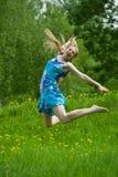 Menina adolescente de salto Imagens de Stock Royalty Free