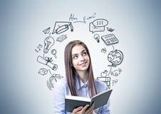 Menina adolescente de sorriso no azul, livro, ícones da educação Fotos de Stock Royalty Free