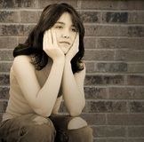 Menina adolescente deprimida triste Fotografia de Stock Royalty Free