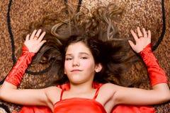 Menina adolescente do retrato no vermelho Fotos de Stock