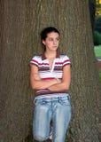 Menina adolescente e árvore Imagem de Stock Royalty Free