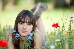 Menina adolescente nas flores Fotos de Stock Royalty Free