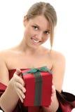 Menina adolescente nova que dá o feriado atual imagens de stock royalty free