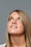Menina adolescente que olha acima Imagem de Stock Royalty Free