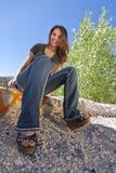 Menina adolescente que senta-se na borda Imagem de Stock Royalty Free