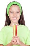 Menina adorável com muitos lápis coloridos Fotos de Stock Royalty Free
