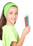 Menina adorável com muitos lápis coloridos Fotografia de Stock Royalty Free
