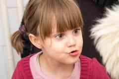 Menina adorável com tranças e os olhos grandes Imagens de Stock Royalty Free