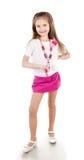 Menina adorável de sorriso na saia com grânulos imagem de stock royalty free