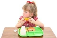 Menina adorável infeliz com almoço de escola foto de stock