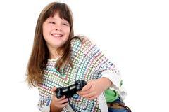 Menina adorável que joga os jogos video imagem de stock
