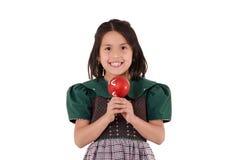 Menina adorável que veste um feriado verde do Natal Imagens de Stock