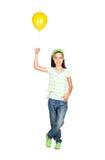 Menina adorável com balão amarelo Fotos de Stock Royalty Free