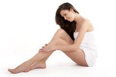 Menina adulta bonita com pés agradáveis Imagem de Stock Royalty Free