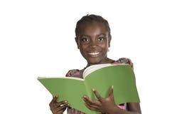 Menina africana com livro de texto Fotos de Stock