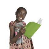 Menina africana com livro de texto Fotos de Stock Royalty Free