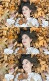 Menina agradável coberta com as folhas outonais Jovem mulher que estabelece na terra coberta pela folhagem de outono no parque Me Foto de Stock Royalty Free