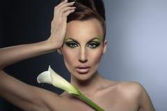 Menina agradável com flor Imagens de Stock