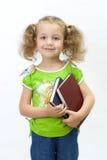 A menina agradável com o livro Fotos de Stock