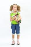 A menina agradável com o livro Imagens de Stock