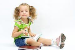 A menina agradável com o livro fotografia de stock