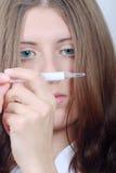 A menina agradável com o termômetro médico fotos de stock royalty free