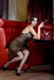 A menina agradável fuma Imagens de Stock Royalty Free