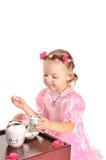 Menina agradável que come o chá no branco imagens de stock