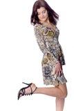 Menina agradável que mostra seus pés magros Fotografia de Stock
