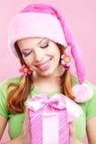 Menina alegre com presente Imagens de Stock Royalty Free
