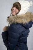 Menina alegre em um casaco azul foto de stock
