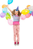 Menina alegre feliz que salta com balões Imagem de Stock Royalty Free