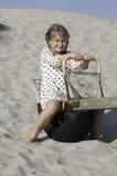 Menina alegre no balanço de madeira Foto de Stock Royalty Free