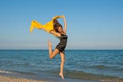 Menina alegre nova no mar Foto de Stock Royalty Free