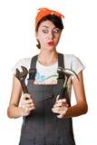 Menina amedrontada com martelo e chave inglesa Imagem de Stock