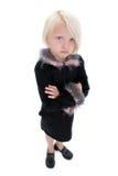 Menina amuando pequena bonita no terno preto com penas cor-de-rosa Fotografia de Stock Royalty Free