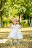 A menina anda no parque Foto de Stock
