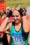 Menina após a terminação do procedimento da raça e da água Foto de Stock Royalty Free
