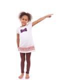 Menina asiática africana que aponta algo Imagem de Stock Royalty Free