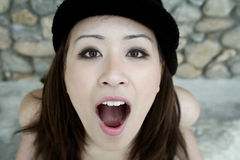 Menina asiática bonita com a boca aberta Imagens de Stock Royalty Free