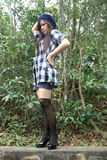 Menina asiática bonita que olha ao lado Foto de Stock