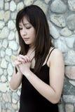 Menina asiática bonita que praying Imagem de Stock Royalty Free