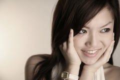 Menina asiática com mãos na face Imagem de Stock Royalty Free