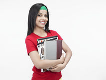 Menina asiática com seus livros Imagem de Stock Royalty Free