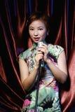 Menina asiática 1 da salmodia da beleza fotografia de stock