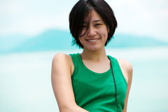 Menina asiática de sorriso Foto de Stock Royalty Free