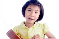 Menina asiática engraçada que joga a guitarra isolada Imagens de Stock