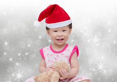 Menina asiática feliz com chapéu do Natal Foto de Stock