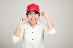 Menina asiática feliz com chapéu vermelho Foto de Stock Royalty Free